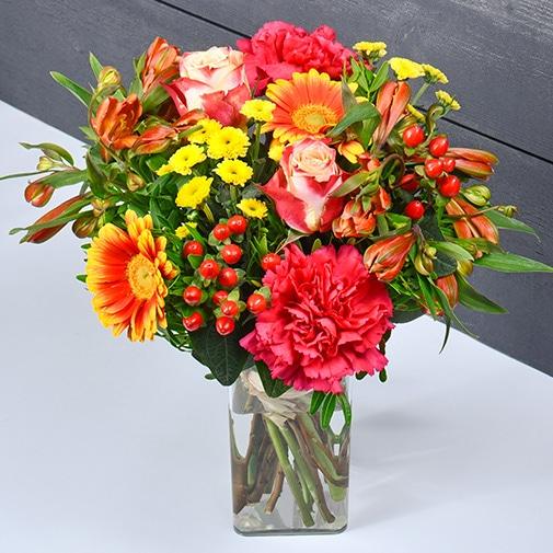 Bouquet de fleurs Tutti frutti et son vase offert